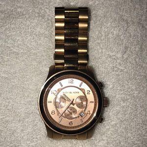 Michael Kors Rose Gold-toned women's watch.